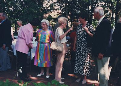 Celebration: July 11, 2002; Actual Birthday: July 16, 2002. Woman in the center holding a shoulder bag is Gloria Singletary speaking with George and Mrs. Zack, Director of Lexington Philharmonic Orchestra and Mrs. Rosenthal is in the multi-colored dress and is standing beside Gloria Singletary