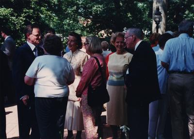 Celebration: July 11, 2002; Actual Birthday: July 16, 2002. Dr. Todd speaking to guests and Ruth Landrum on his left with beige dress and glasses