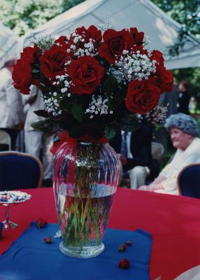 Celebration: July 11, 2002; Actual Birthday: July 16, 2002. Vase of roses with Rosemary Brooks sitting on the far right