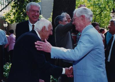 Celebration: July 11, 2002; Actual Birthday: July 14, 1903. Charles Shearer, President of Transylvania, George Herring, UK Professor of history in the center, and Dr. Clark is shaking hands with former UK President Frank Dickey