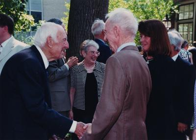Celebration: July 11, 2002; Actual Birthday: July 14, 1903. Thomas D. Clark shaking hands, Dottie Leathers Herring, spouse of George Herring, and Hillary Boone, UK benefactor