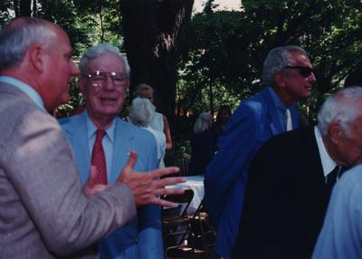 Celebration: July 11, 2002; Actual Birthday: July 14, 1903. Left to right: unidentified person, former UK Presidents Frank Dickey (red tie) and Otis Singletary in sunglasses. Dr. Clark is to the far right