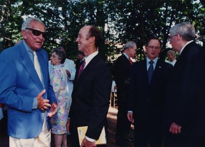 Celebration: July 11, 2002; Actual Birthday: July 16, 2002. Left to right: unidentified person, former UK President Otis Singletary in sunglasses, unidentified man, Dr. Todd, and Charles Shearer, Transylvania President