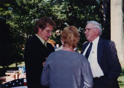 Celebration: July 11, 2002; Actual Birthday: July 16, 2002. Left to right: former UK professor Wimberly Royster, and unidentified people