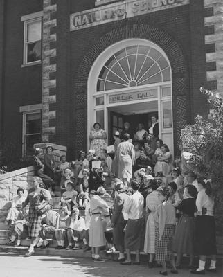 Registration and Freshman Week--students on steps of Miller Hall, coming down on the left is Susan Haselden, top left side is Kay Vaughn, coming down the middle is Margaret Futrell