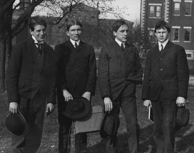 Print by Bob May (1965); from left to right: Claire Porter St. John, Patrick Owen Hunter, William Edwin Freeman, Edward Thomas Bowling; all B. M. E graduates