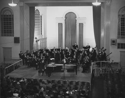 Louisville Orchestra performing at Memorial Hall for final program of Founders' Week. Robert Whitney is conducting and Nathaniel Patch is piano soloist. Photographer: John B. Kuiper