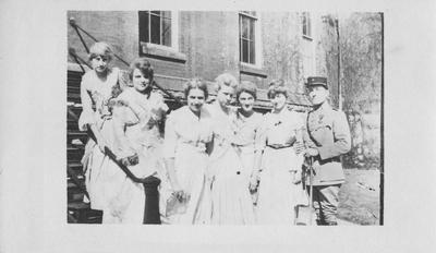 Seven unidentified people standing in front of the Administration Building. This photo was accessioned on January 3, 1966 from the Administration Building