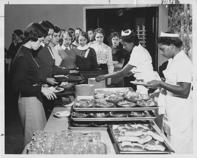 A group of unidentified women waiting in line to get food. Photographer: John Mitchell