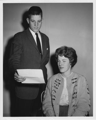 Two students looking at a letter of UK representatives