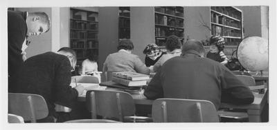Students studying in a library; Northwest Center University of Kentucky in Henderson, Kentucky
