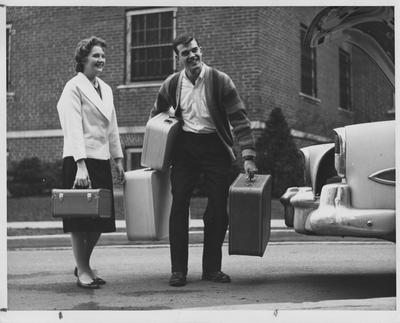 Steve Clark (right) is standing next to Barbara Zweifel (left) and is carrying Barbara's luggage. This photo appears on page 4 in the 1960 K-Book