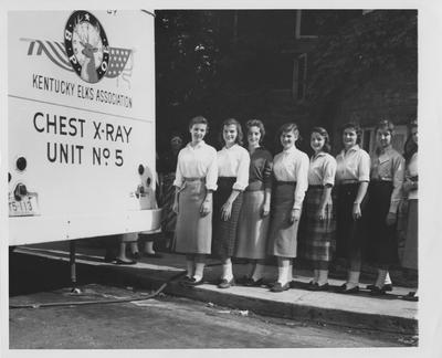 Women standing by Kentucky Elks Association Chest X-Ray Unit truck. Elaine Long in second from left. Photographer: Billy Davis