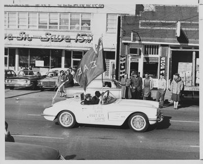 Homecoming Parade in downtown Lexington. Sigma Alpha Epsilon fraternity in a corvette with