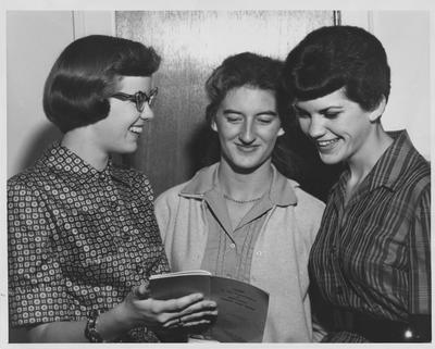 Three women looking at
