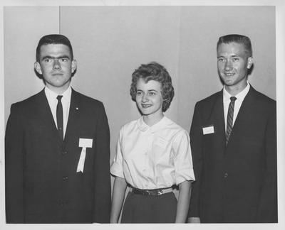 Two unidentified men and one unidentified woman; 4-H state officers