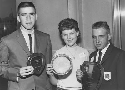 From left to right: Carter Blevins, Susan Johnson, and Billy Harper are all holding their 4-H awards. Photographer: Public Information Department, University of Kentucky