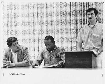 Three unidentified people at a Community Alliance for Responsible Action (C.A.R.S.A) meeting. This image appears second on page 255 in the 1969 Kentuckian