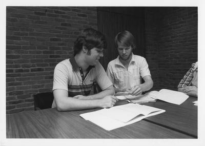 Mr. Mancuso (left) and Mr. Jones (right) are studying
