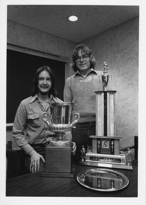 Mr. Skillman (left) and Mr. Oberst (right) are standing with three trophies