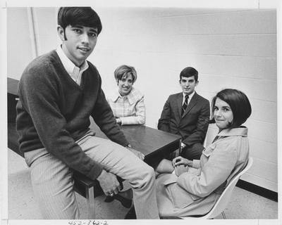 Chairman of Focus; seated at a table (from left to right): Tony Smith, Marilyn Crane, Jim Miller, and Kathy Camicia. This image appears second on page 362 in the 1969 Kentuckian