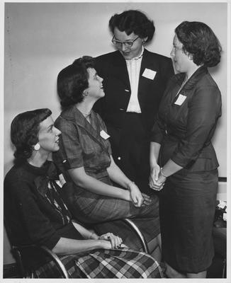 Four unidentified female members of the UK Newcomers Club. Photographer: Herald-Leader. Received October 20, 1959 from Public Relations