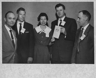 State Utopia Club meeting, 1960, at University of Kentucky; received by Public Relations February 23, 1960; four unidentified men and one woman; Photographer: Lexington Herald - Leader