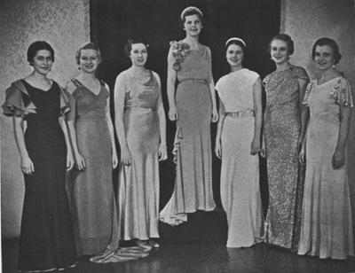 Queen and her court from 1934 Kentuckian: Edna Evans (Class of 1935), Betsy Frye, Scovell Bryant, Ruby Dunn, Marian Conner Dawson - Queen (Class of 1935), Elizabeth Jones (Class of 1935), Bethe Bosworth (Class of 1937); This image is in the 1934 Kentuckian on page 124; This image is in the 1965, May 9 Herald - Leader; Photographer: Lexington Herald - Leader