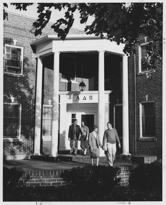 Couples leaving the Alpha Delta Pi sorority house; Boy in front is Jim Baughman