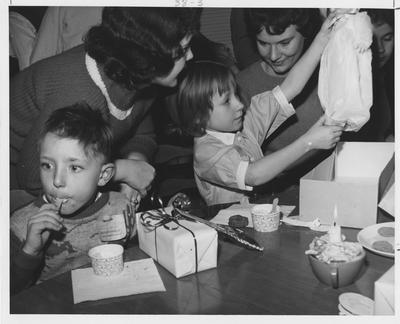 Delta Zeta Christmas party for children; This image is in the 1962 Kentuckian on page 38, image 3
