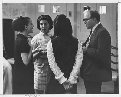 Delta Delta Delta sisters plus a male friend  have tea; The image is in the 1969 Kentuckian on page 311, image 1