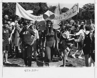 Delta Gamma outside party with Sigma Chi; This image is in the 1969 Kentuckian on page 311, image 1