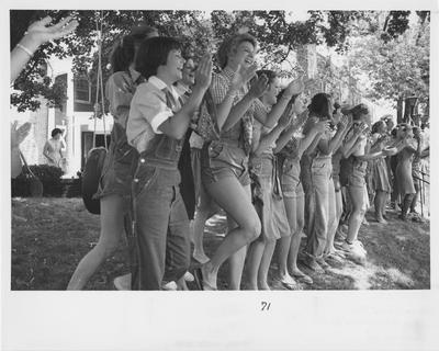 Members of Alpha Delta Pi social sorority welcome Fall rushees with a cheerful song in the 1980s