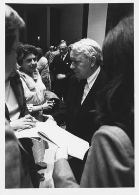 Scotty Reston (center) talk to people at the 1979 Creason Lectures