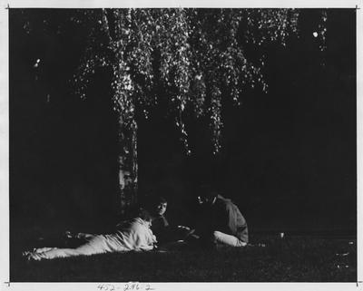 Students under a tree; This image is in the 1969 Kentuckian on page 296, image 2