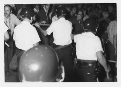 Police hold back protesters during the reaction to the Kent State shootings