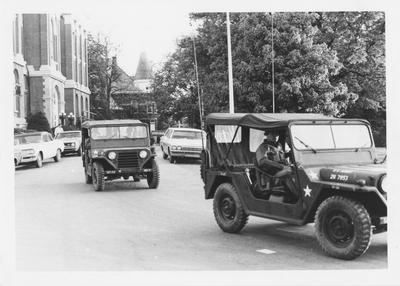 Army Jeeps drive past the Administration Building during the reaction to the Kent State shootings