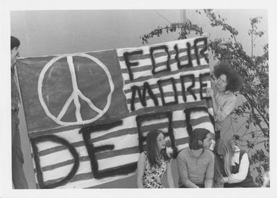 Students hold sign protesting the Kent State shootings