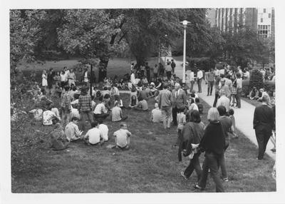 Protesters sitting on the lawn by the UK Student Center