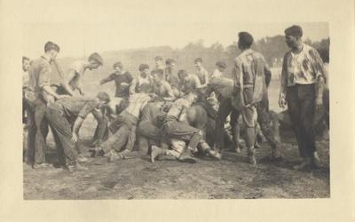 Men in a tug-of-war between the Freshmen and Sophomores at Clifton Pond