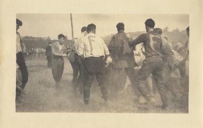 Men in a tug-of-war between the Freshmen and Sophomores at Clifton Pond; The