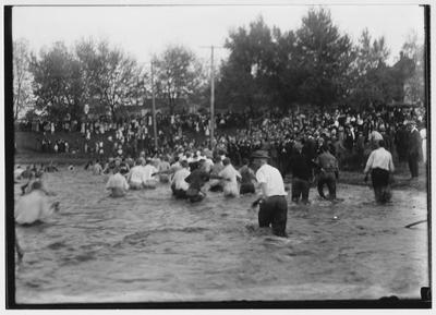 Losers wading out of Clifton pond after the 1914 tug of war; The Freshmen triumphed in this contest held in October