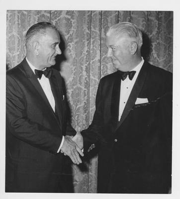 United States President Lyndon B. Johnson (left), greeting an unidentified man
