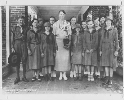 Eleanor Roosevelt at Maxwell Place with a group of Girl Scouts and a Boy Scout