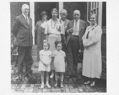 Eleanor Roosevelt visits Maxwell Place; Left to right are: President McVey, Mrs. Ruby Laffoon?, McVey's granddaughter?, Roosevelt, McVey's granddaughter?, Nancy Cook (Democratic party leader), Governor Ruby Laffoon, and Mrs. Frances Jewell McVey