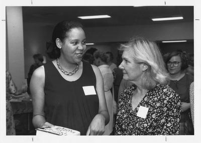 Alicia Helm (left) and Joyce Logan (right) at Woman's Club reception for faculty wives and staff; Photographer: Ken Goad