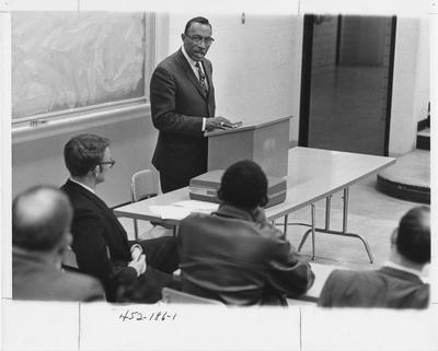 Cal Wallace speaking to a group of students as one of seven seminars of