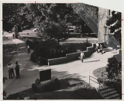 Students walking near the Student Union Building at the old main entrance to campus