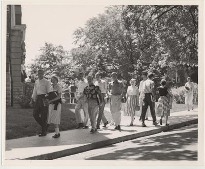 William Curlin (front, far left) and other students walk to and from classes