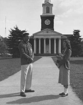 Male and female student talking in front of Memorial Hall